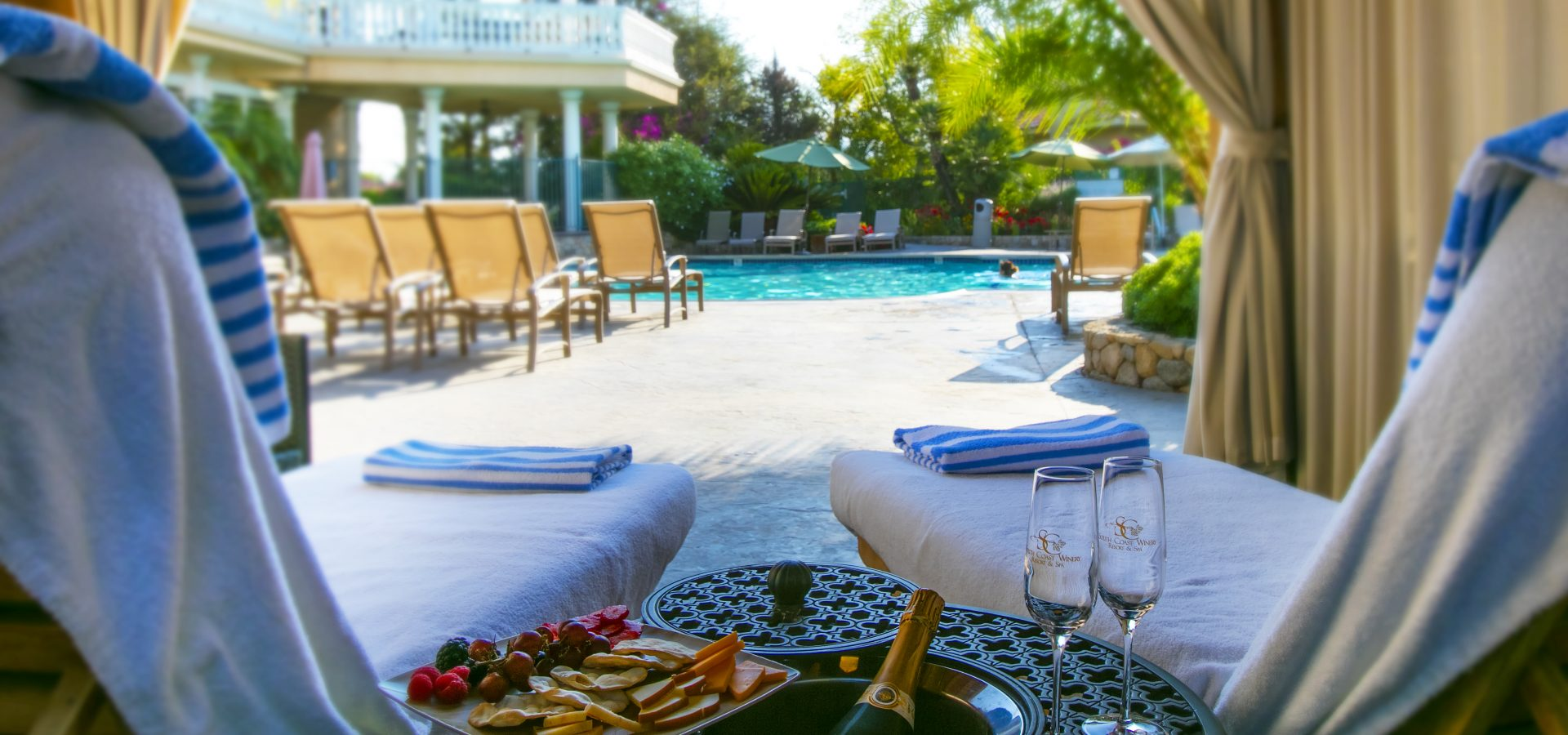 relax with wine and snacks at our outdoor pool area featuring cabanas in Temecula