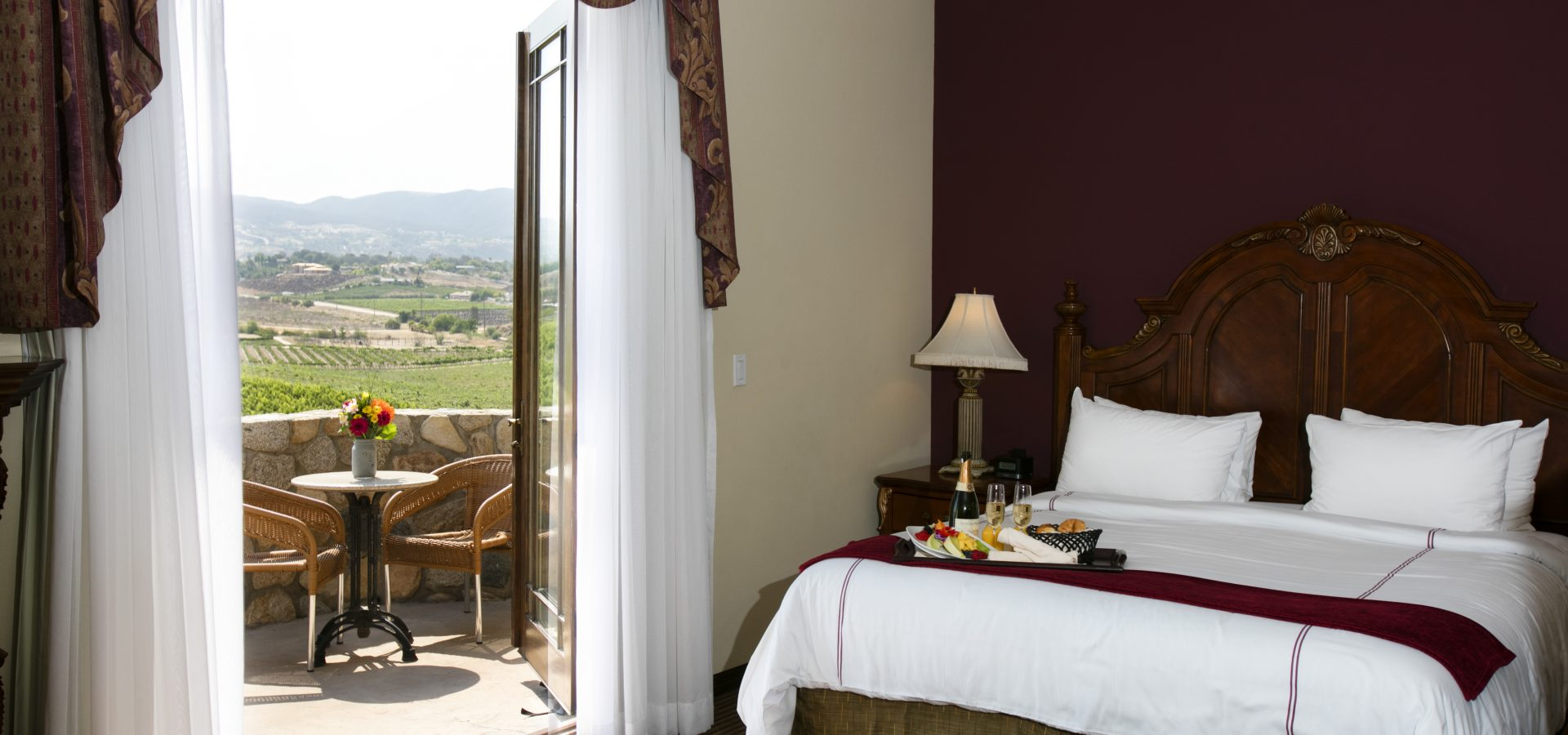 hotel suite with balcony viewing vineyards in Temecula
